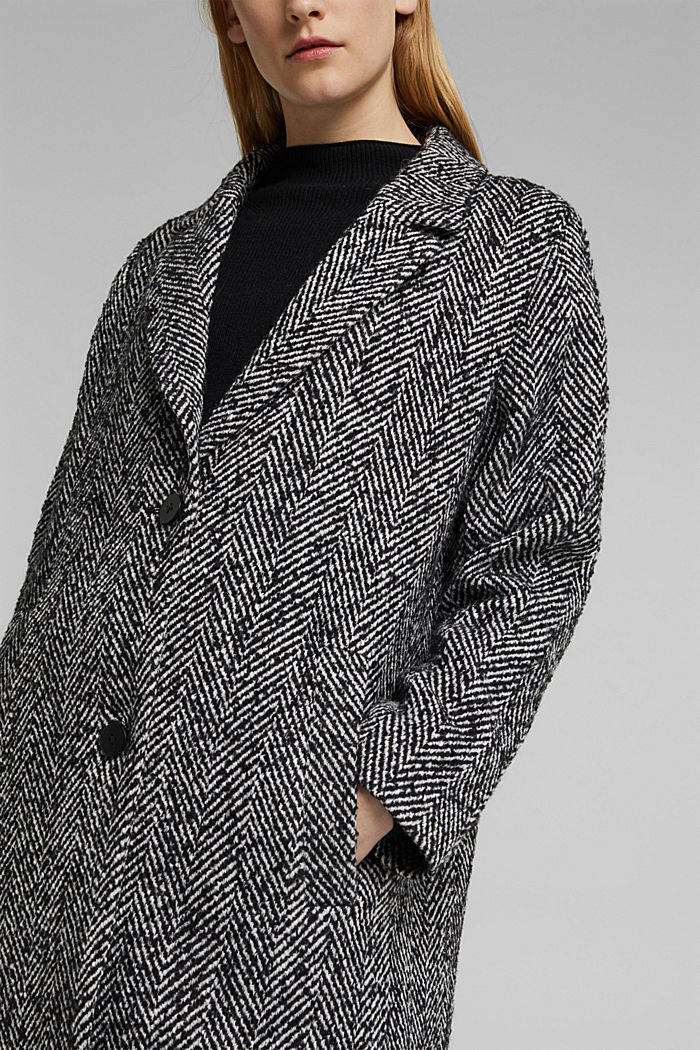 Made of blended wool: herringbone coat