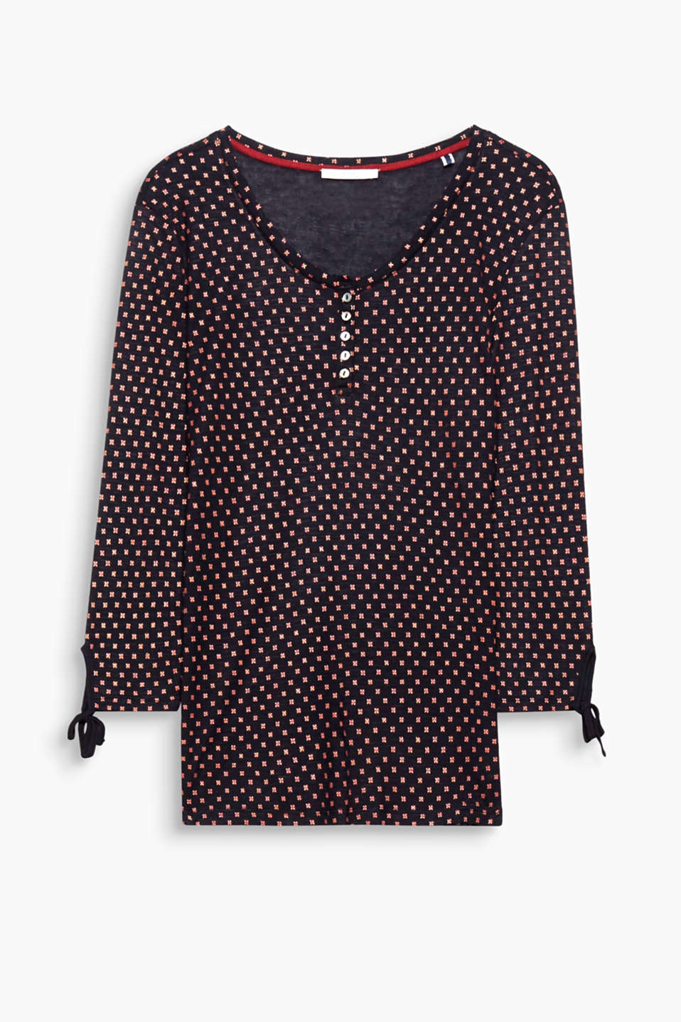 Ties on the sleeves and a minimalistic print give this top its pretty, feminine look.