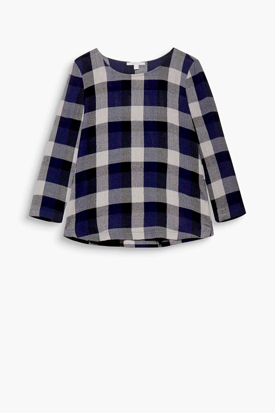 The lightly creased fabric and modern A-line design give this stunningly checked blouse its cool style!