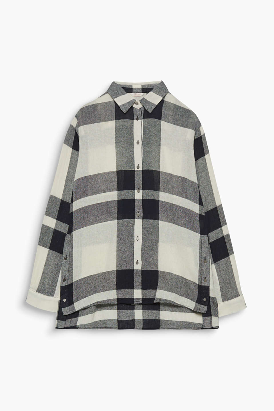 This textured blouse with interwoven XXL checks and button-down hem slits indicates the larger the better!