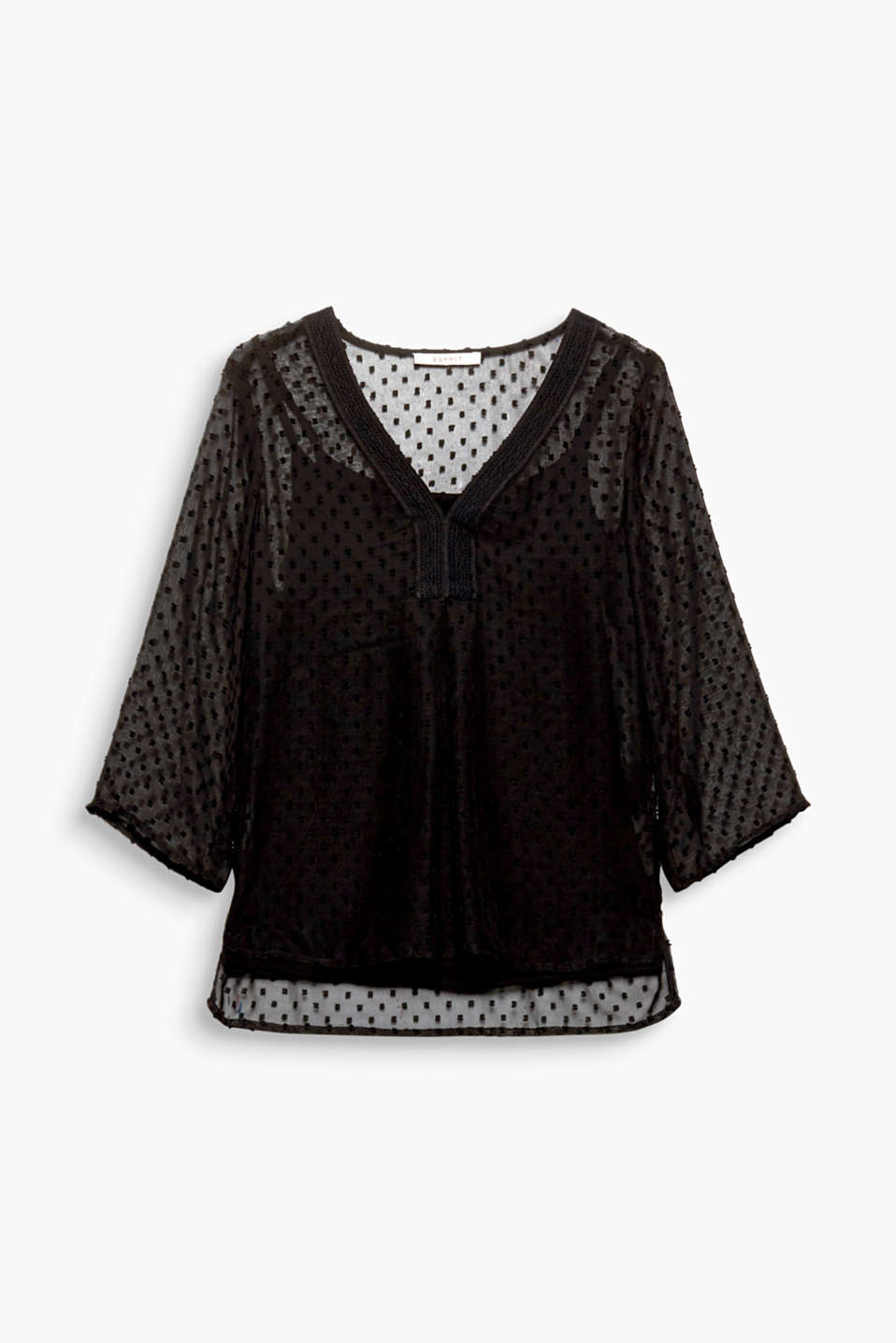 Transparency + decoration: interwoven polka dots and an embroidered neckline decorate this sheer tunic blouse!