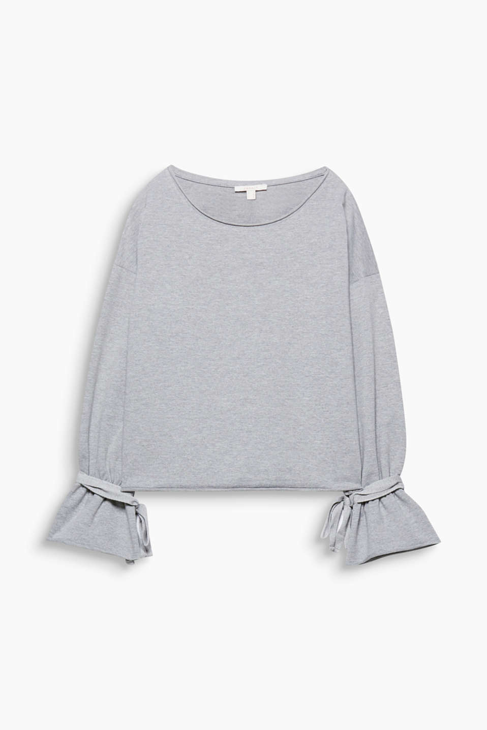 The flounces on the sleeve ends and the wide tie-up bows make this sweatshirt a cool, eye-catching piece.
