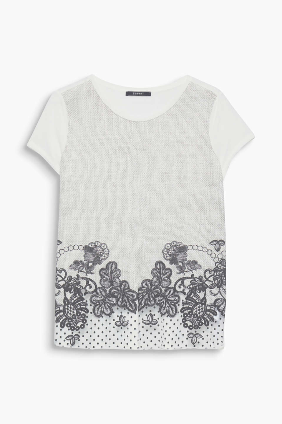 This top adds embellishment to any look with its textured pattern, rubberised flowers and chiffon hem!