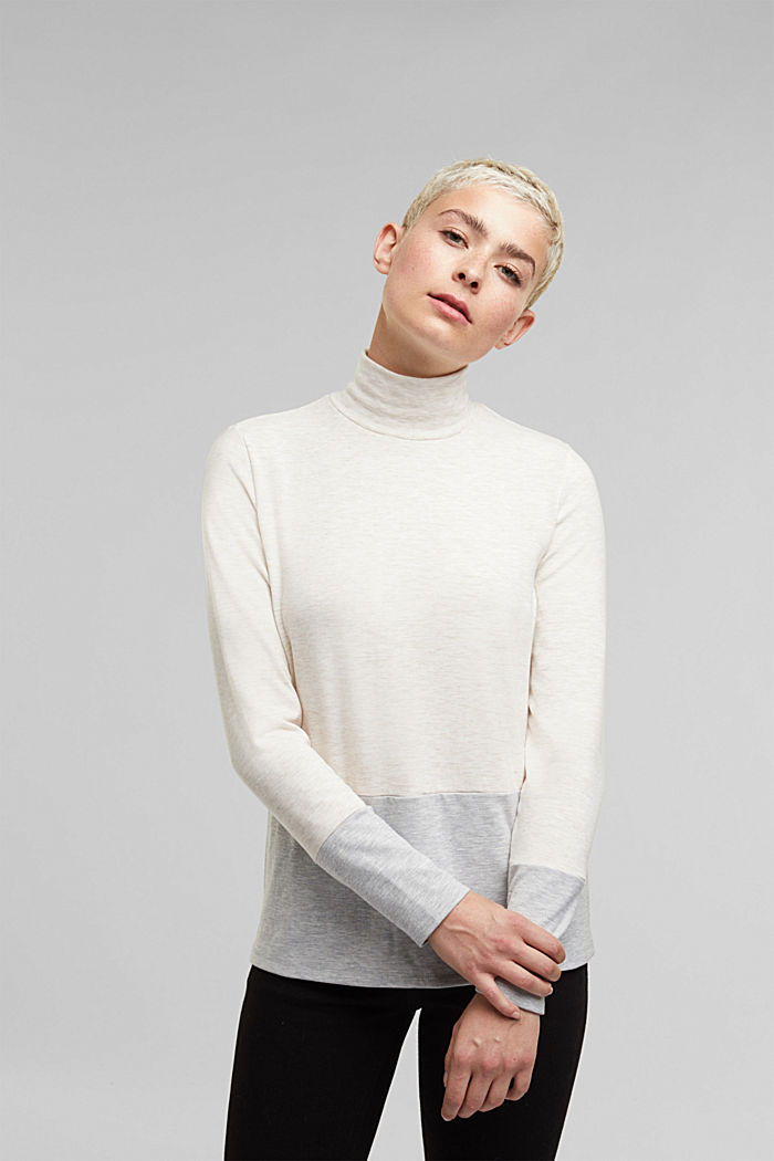 Stand-up collar long sleeve top in a colour block look