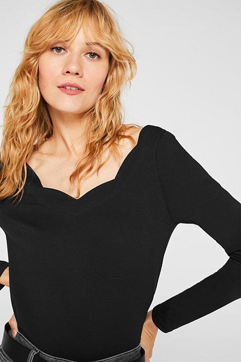 Stretch long sleeve top with a feminine neckline