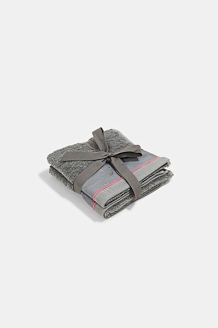 Deux serviettes invités en tissu éponge à bordures à étoiles