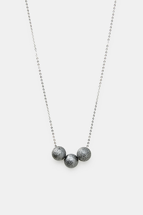 Necklace with a metallic orbs