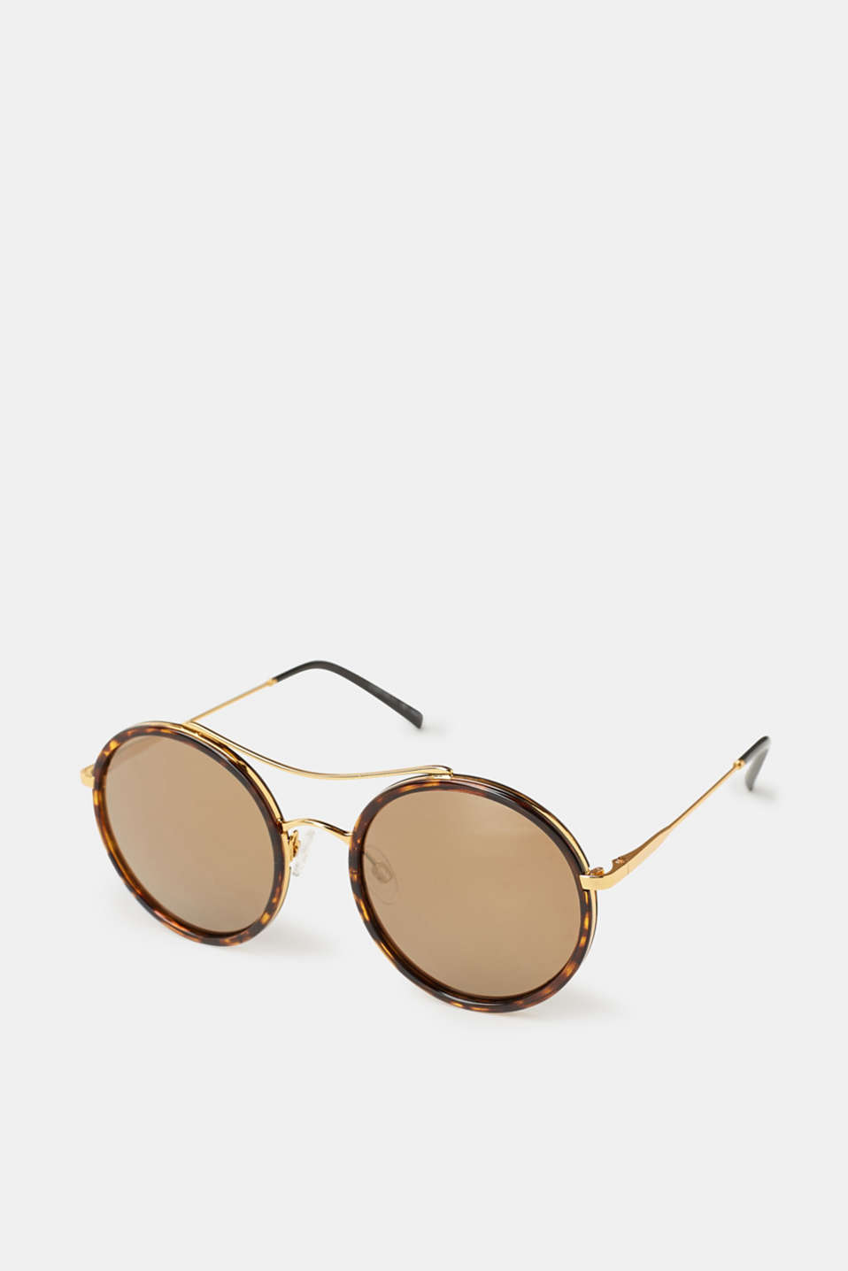 The exciting retro design with gold mirrored lenses and filigree metal temples makes these sunglasses trendy head-turners.