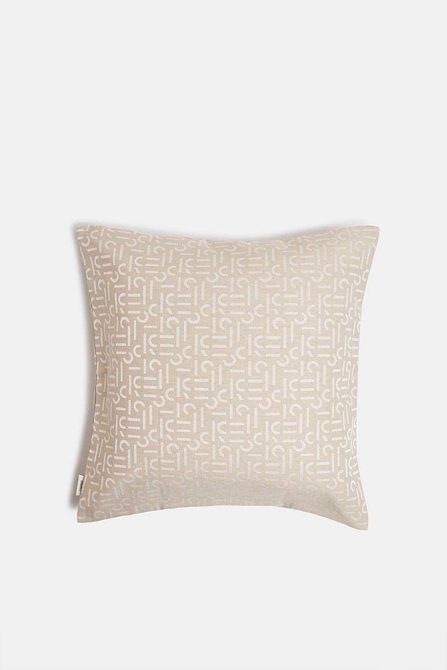 Cushion cover with a woven pattern