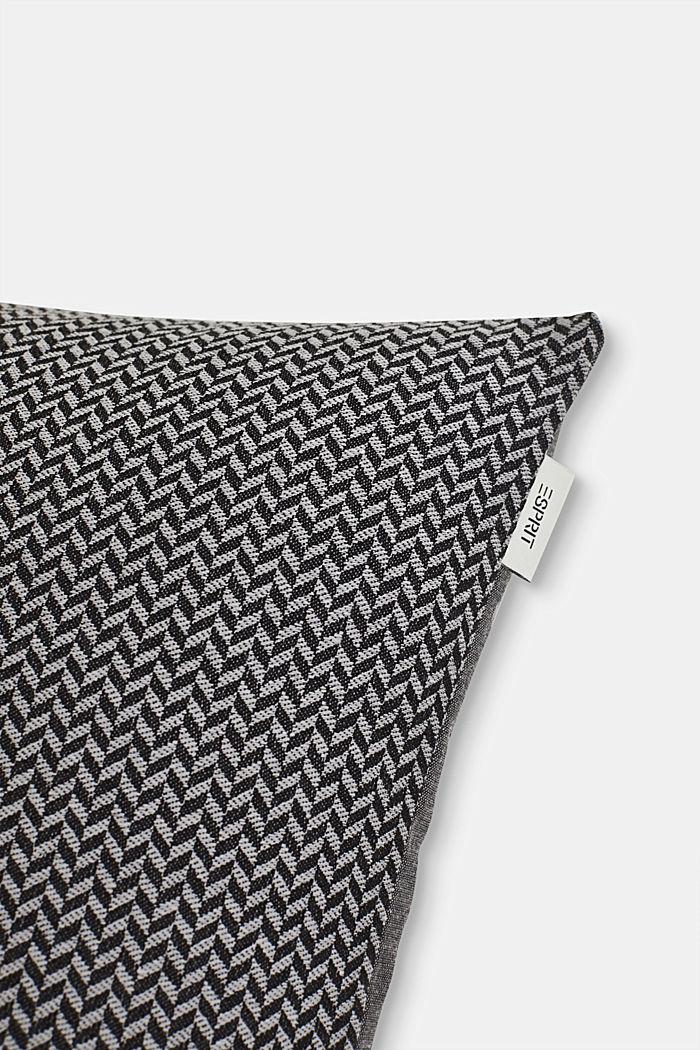 Cushion cover with a herringbone texture