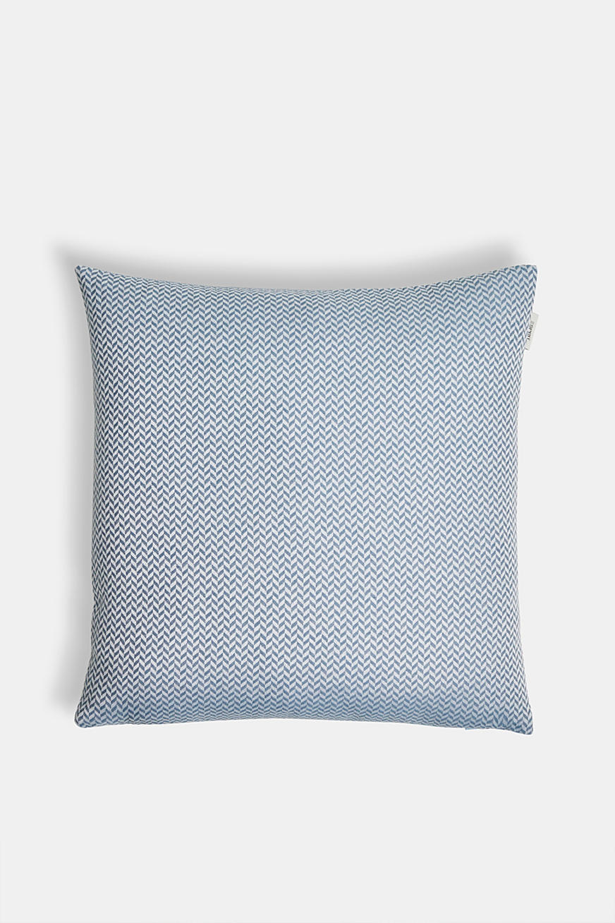 Cushion cover with a herringbone texture