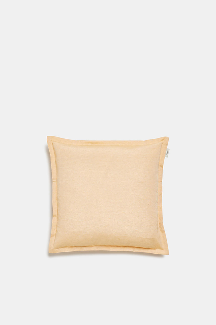 Cushion cover with tucked hem