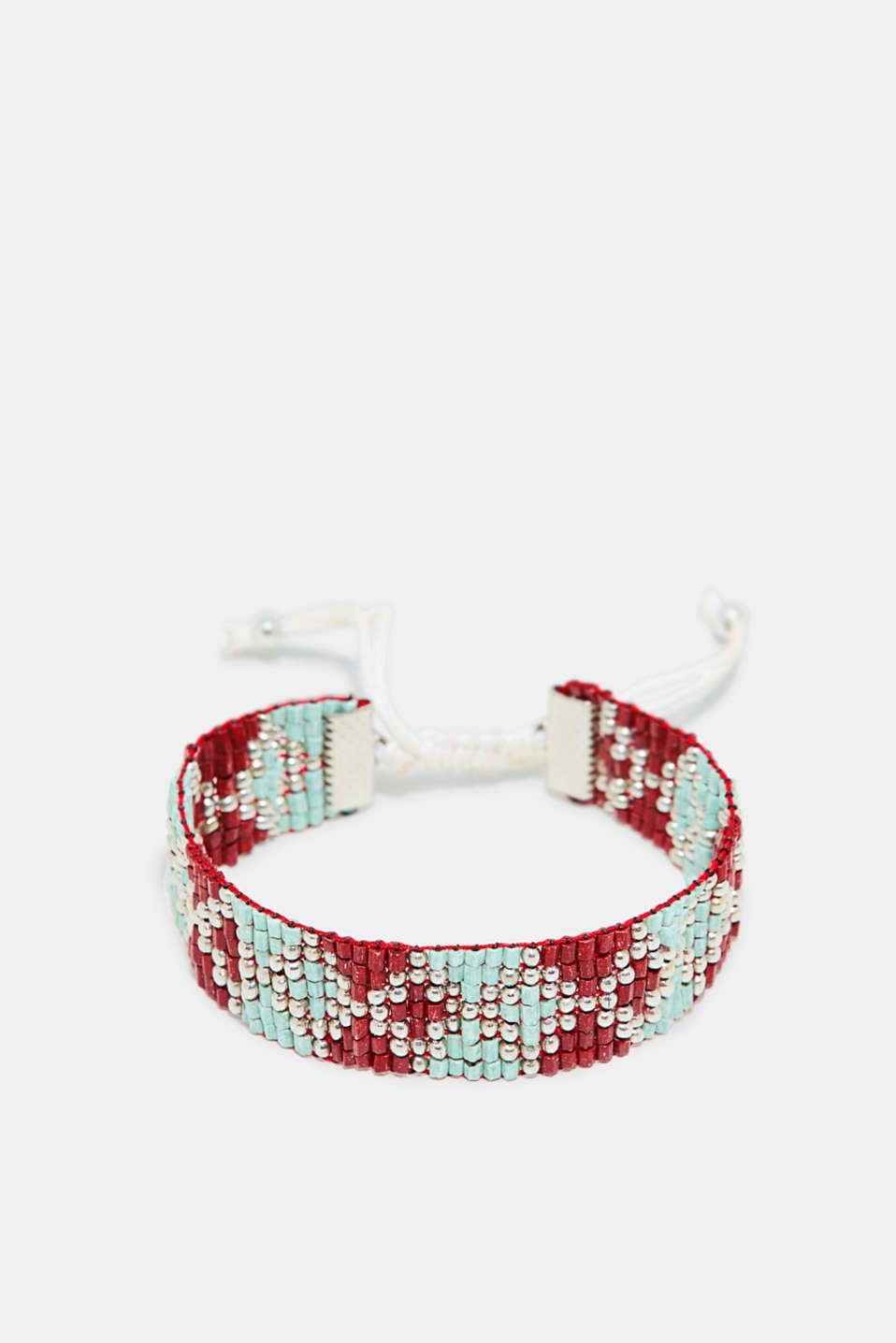 Countless beads in different shapes adorn this bracelet with an adjustable sliding clasp.