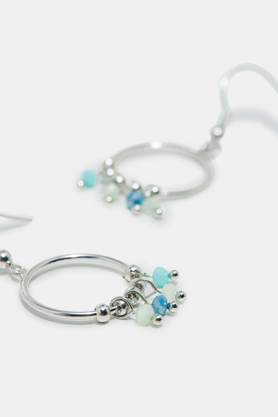 Earrings with hoops and gemstones