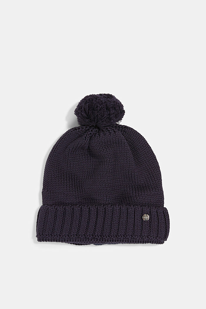 Knitted hat with a pompom