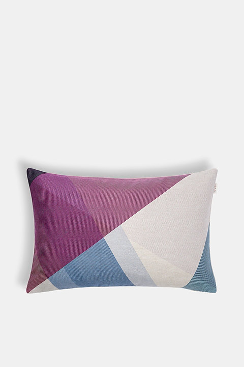 Woven cushion cover with a geometric pattern