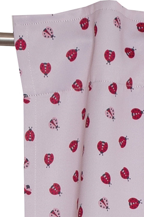 Dim-out curtain with a ladybird print