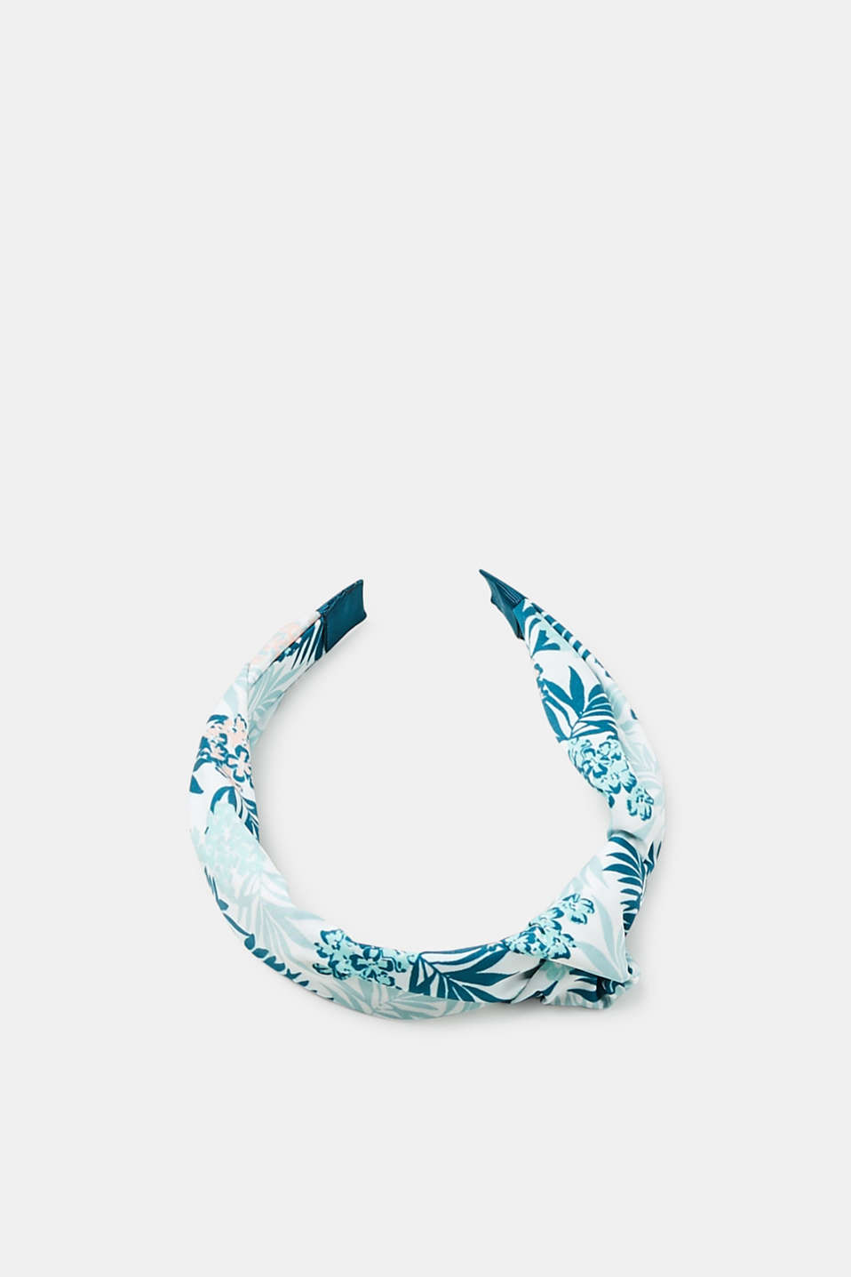 This wide hairband is a trendy accessory thanks to the summery textile overlay with a leaf and floral print.