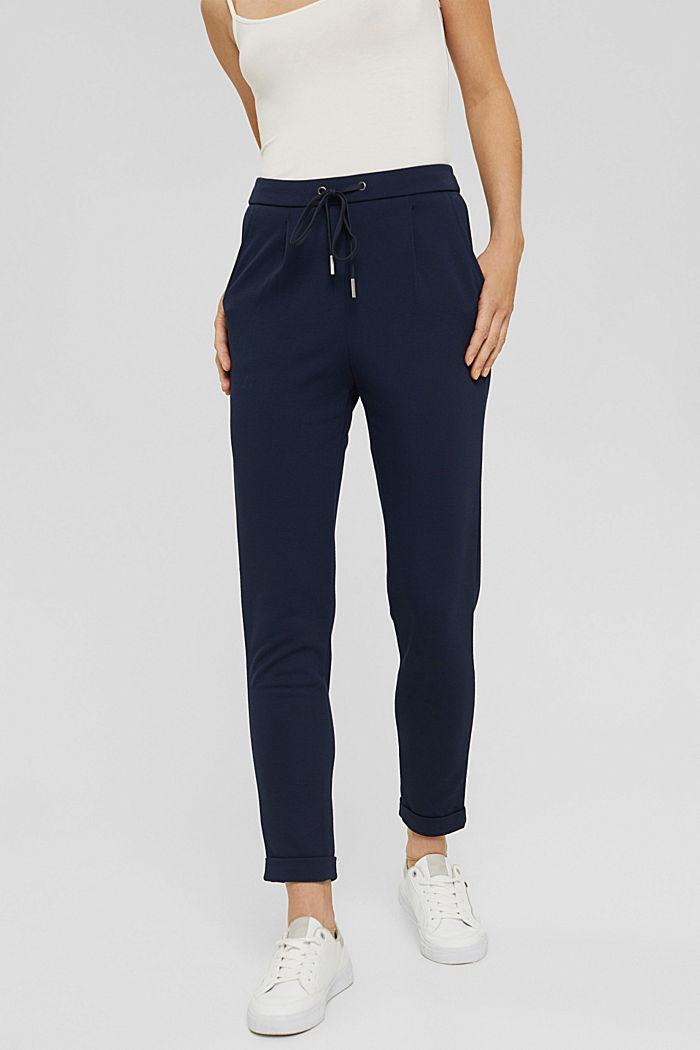 Z recyklingu: spodnie ze streczem z gumką w pasie