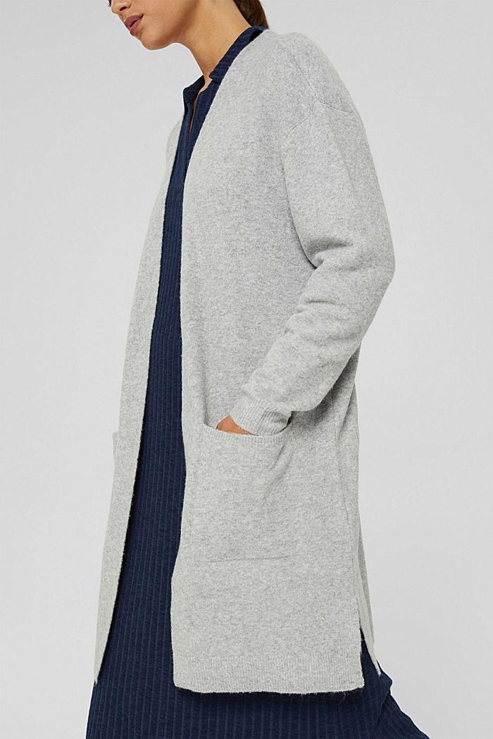 Sisältää villaa: pitkä avonainen neuletakki