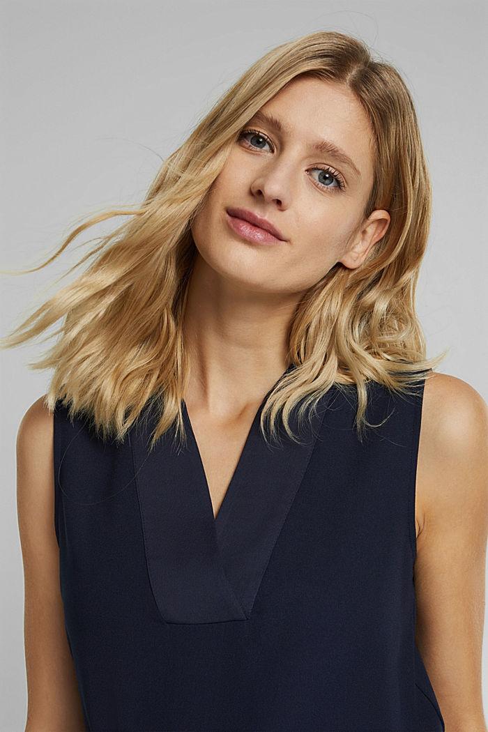 Top façon blouse en crêpe fluide