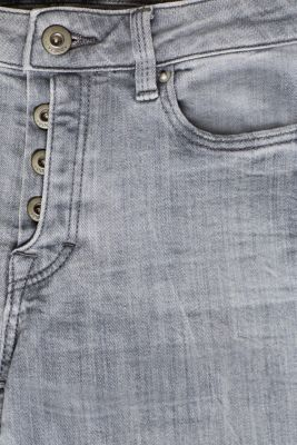 Stretch jeans with a half concealed button placket