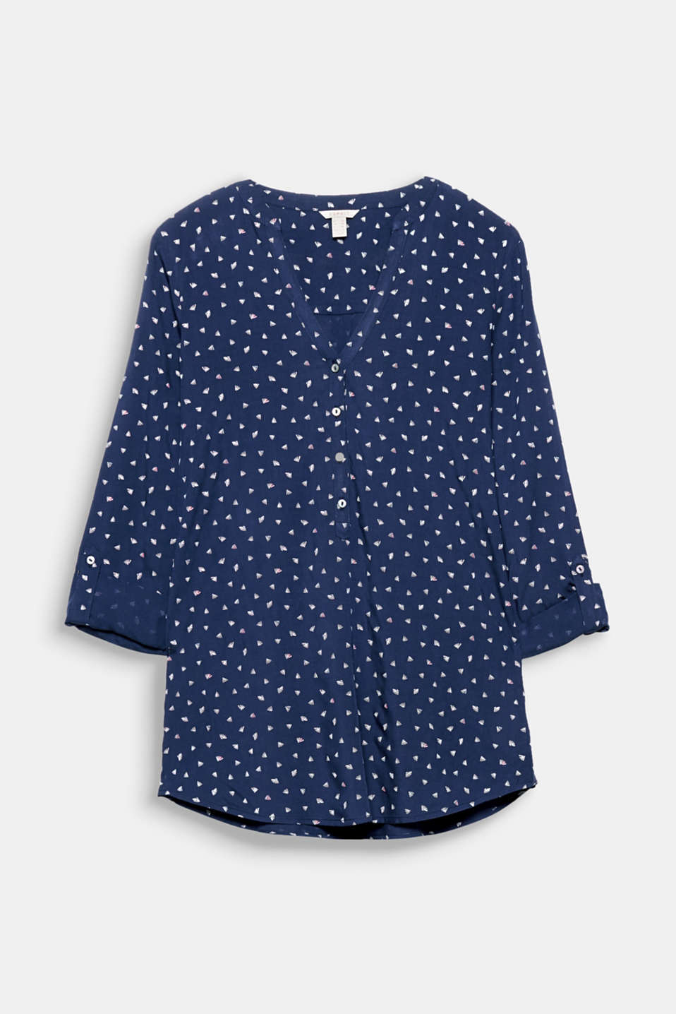 This print blouse with a Henley neckline and turn-up sleeves is the perfect essential piece for many occasions!
