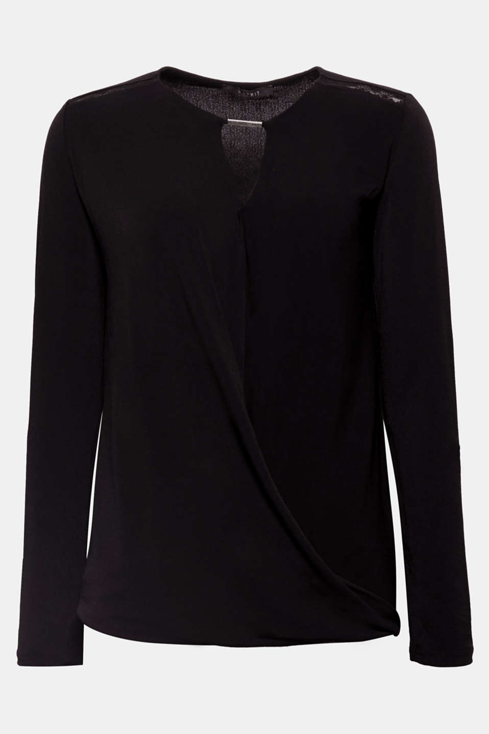 Casual and chic, this long sleeve top with stretch for comfort features a wrap-over effect and decorative details.