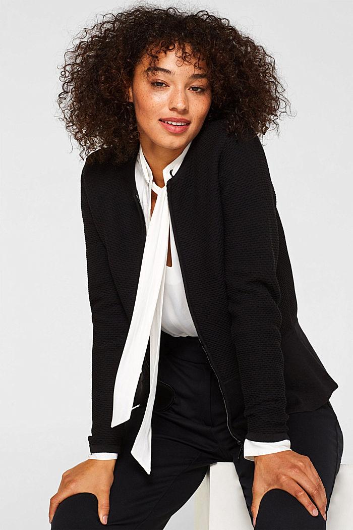 Textured cardigan with a peplum