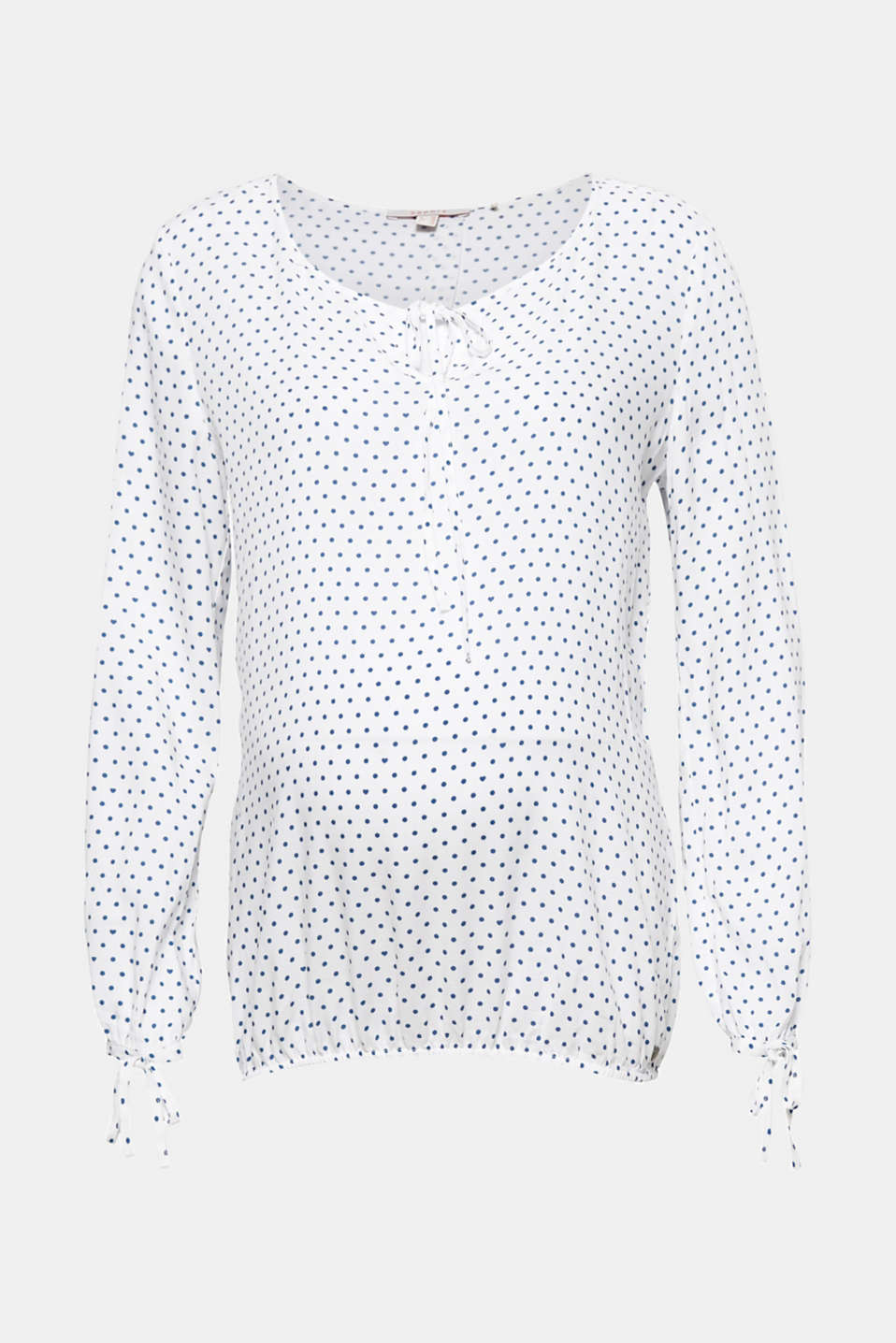 This flowing blouse with a fashionable polka dot print will be your lightweight, soft and comfy favourite piece!