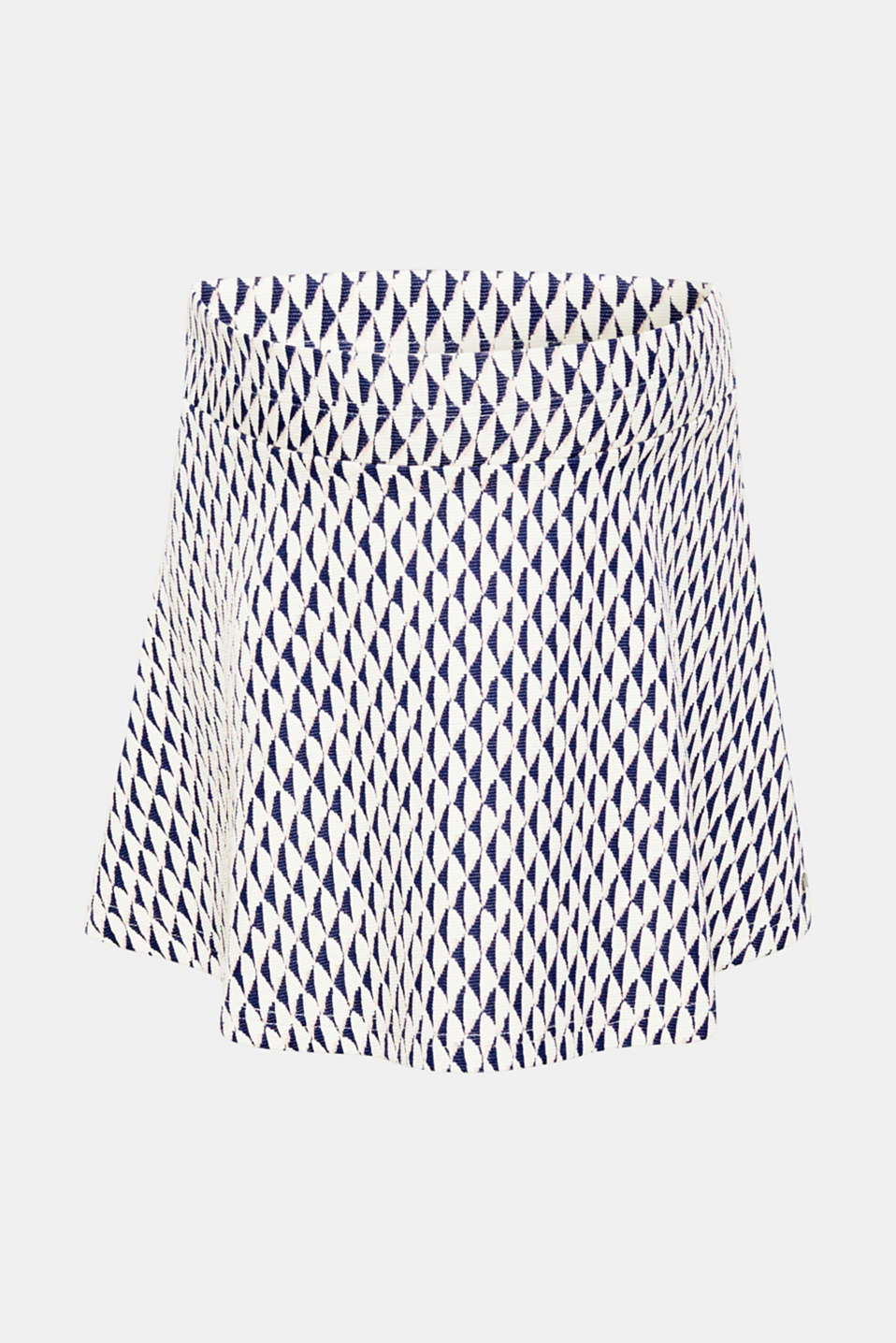 Stylish thanks to the trendy diamond pattern, functional thanks to the under-bump waistband: this jacquard mini skirt.