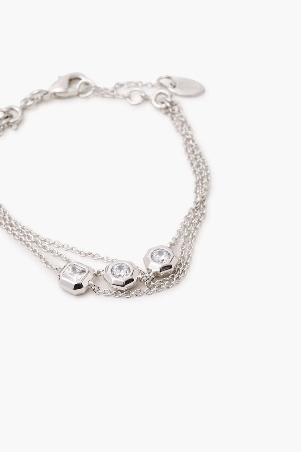 Three-strand bracelet in metal / zirconia