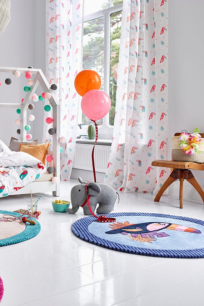 Kinderteppich mit fröhlichem Tukan
