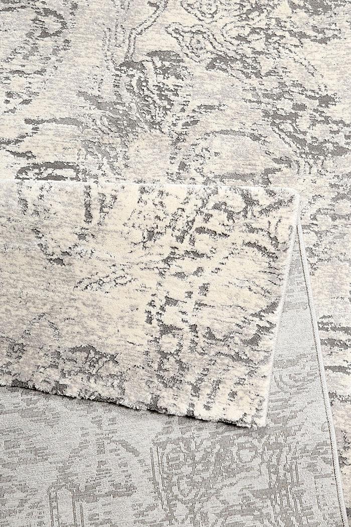 Web-Teppich mit Ausbrenner-Technik