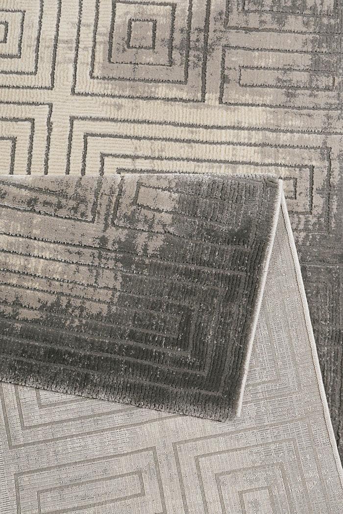 Web-Teppich mit geometrischem Muster