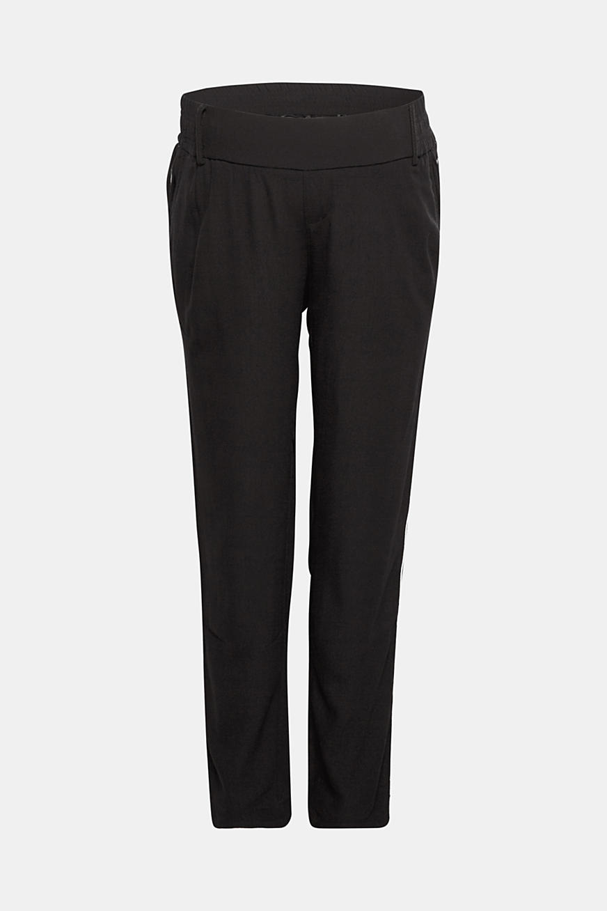 Piped trousers with an under-bump waistband