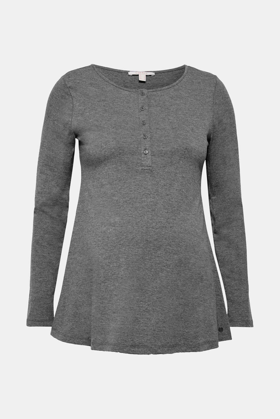 This fashionably flared, A-line long sleeve top featuring a long button placket and comfy nursing options is simple and trendy!
