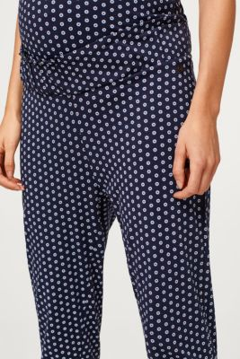 Trousers with an under-bump waistband containing organic cotton