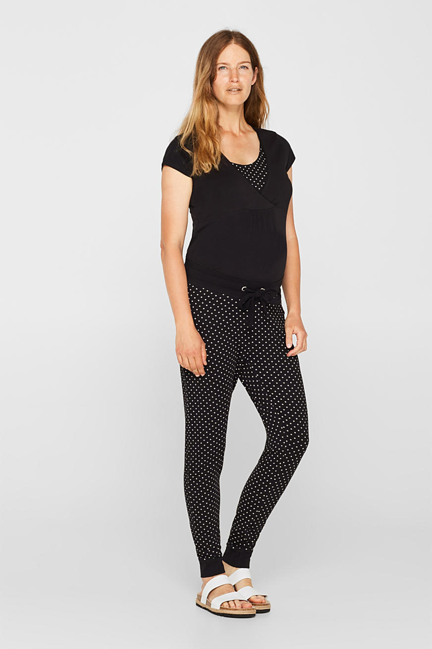 Stretch trousers with an under-bump waistband