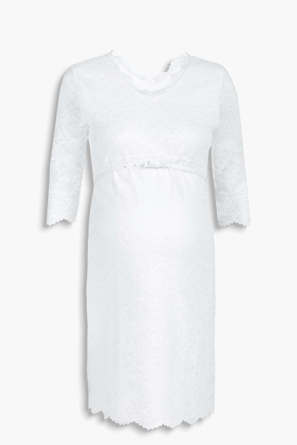 with a double V-neckline, three-quarter length sleeves and a bow belt