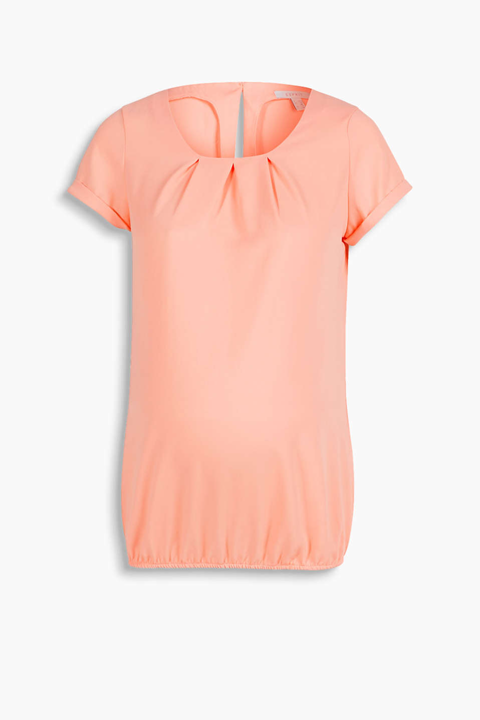 in a loose form, with an elasticated hem and a pleated neckline