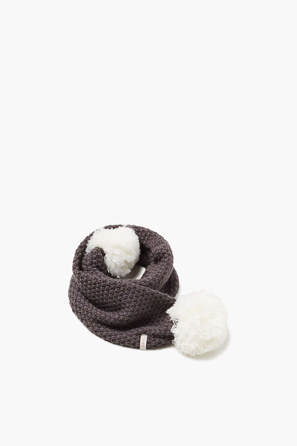Unbelievably unique! The eye-catching pompoms on both ends make this knit scarf a sensationally sweet accessory!