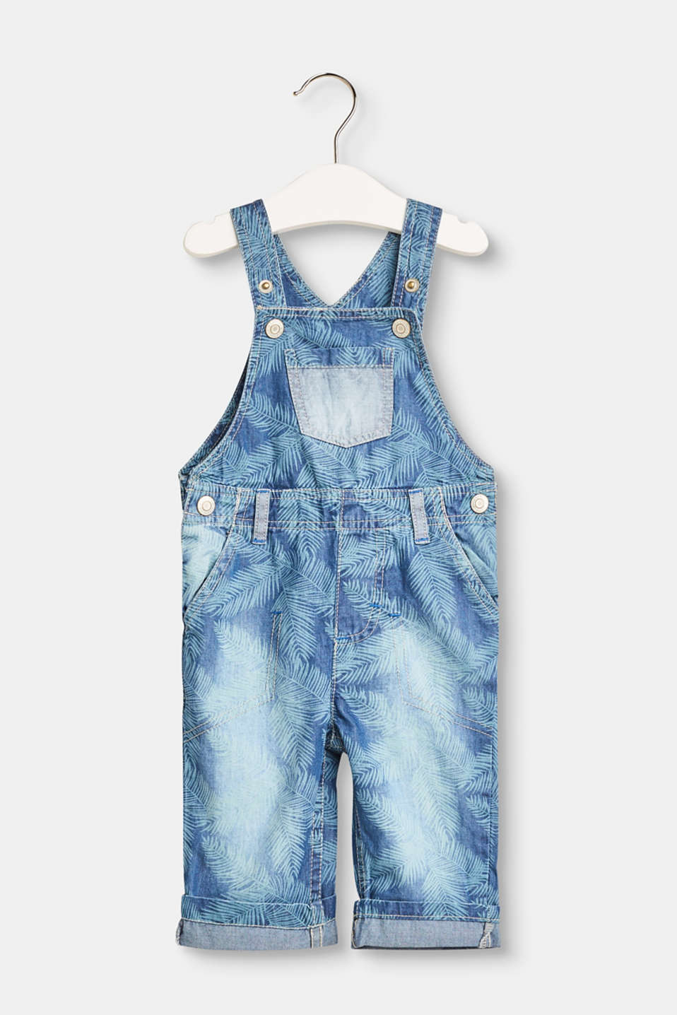 These cotton denim dungarees with a summery palm tree print and plain coloured details is particularly light and smooth!