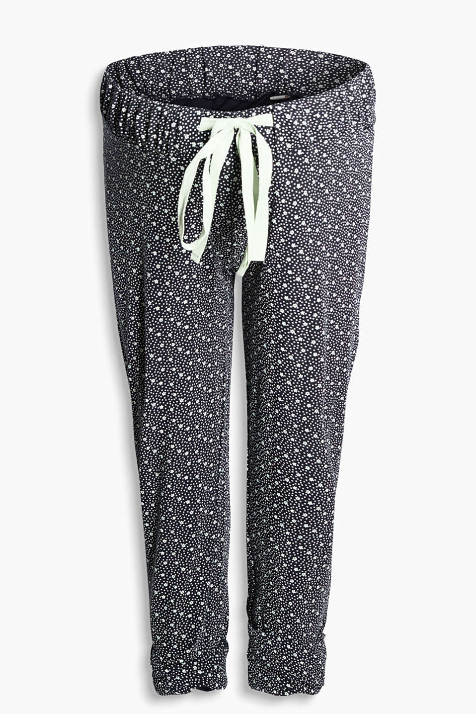 With a pretty floral design: Trousers made from soft stretch jersey with a wide elasticated waistband